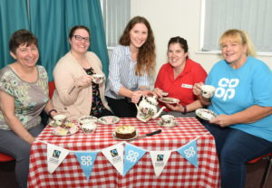 Annie Clewlow, Communicare Manager, Faith Kenny, Communicare Volunteer Coordinator and Hannah Silver, Communicare Project Leader with Louise Mackney, one of the Red Cross community connectors